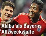 Bayern Münchens David Alaba und Mario Gomez jubelnd
