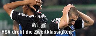 Die enttäuschten HSV-Spieler Mladen Petric und Michael Mancienne