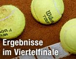 Drei Tennisbälle liegen beieinander