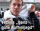 Sebastian Vettel (Red Bull) trocknet sich mit einem Handtuch ab