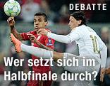 Luiz Gustavo (Bayern) und Mesut Oezil (Madrid)