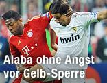 David Alaba (Bayern München) im Zweikampf mit Madrids Sami Khedira