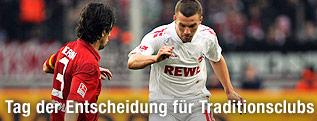 Lukas Podolski (Köln) und Levan Kobiashvili (Hertha)