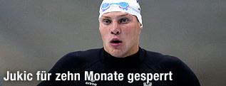 Dinko Jukic mit ernstem Blick im Schwimmanzug