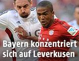 Roberto Hilbert (Leverkusen) und Douglas Costa (Bayern)