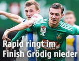 Thomas Goiginger (Groedig) and Mario Pavelic (Rapid)
