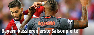 Yannick Carrasco (Atletico) und Jerome Boateng (Bayern)