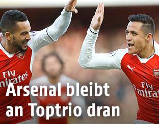 Jubel von Arsenals Alexis Sanchez und Theo Walcott