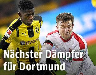 Daniel Baier (Augsburg) Ousmane Dembele (Dortmund)
