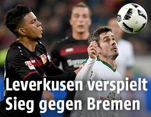 Benjamin Henrichs (Leverkusen) und Fin Bartels (Bremen)