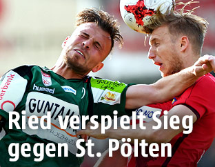 Orhan Ademi (Ried) and Michael Huber (St.Poelten)