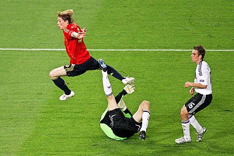Fernando Torres (ESP), Jens Lehmann und Philipp Lahm (GER)