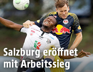 Issiaka Ouedraogo (WAC) and Stefan Stangl (RBS)