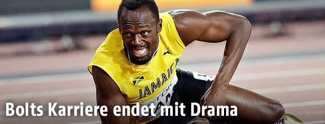 Leichtathlet Usain Bolt liegt am Boden