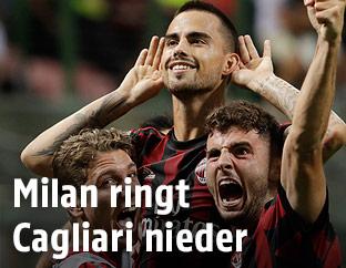 Milan-Spieler jubeln