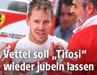 Sebastian Vettel und Maurizio Arrivabene