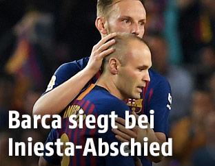 Andres Iniesta und Ivan Rakitic (beide Barcelona)